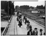 Japanese American families leaving Bainbridge Island, March 31, 1942