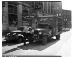 Patrolman citing a truck for double parking, September 1941