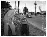 Man measuring traffic speed, July 8, 1947