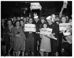 Group displaying V-J Day newspapers, August 14, 1945