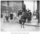 Bonny Ann Weber on rearing pony in Potlatch parade, Seattle, 1941