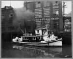 "Tug ""Trio"" at Seattle waterfront, 191-?"