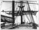 Bending the foresail, ca. 1905