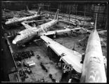 Boeing 747 assembly plant showing four 747s under construction, ca. 1969