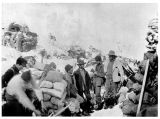 Men with piles of supplies at Chilkoot Pass, ca. 1898