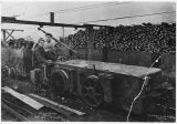 Two men with a coal car at the Renton Coal Mine, October 1916
