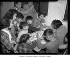 Interned children playing Monopoly at Camp Harmony, Puyallup, 1942