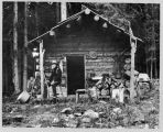 David Denny at log cabin near Lake Keechelus, 1899
