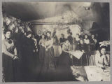 Women and men at a party in Nome, ca. 1901