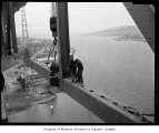 Last piece of steel closes span on Lake Washington Ship Canal Bridge, Seattle, 1961
