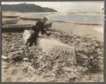 Young Doctor carving a canoe at Neah Bay, July 27, 1914