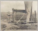 Child near mining equipment, Nome, August 30, 1906