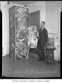 Kenneth Callahan with some of his paintings, probably in Seattle, 1937