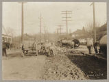 Removing street bricks to lay water main in Renton, February 23, 1923
