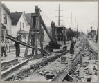 Tearing up streetcar tracks in downtown Seattle, August 21, 1941