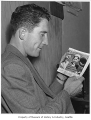 Fred Hutchinson looking at photo, Seattle, 1946