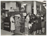 Women shopping for citrus fruit at Rhodes Brothers Ten Cent Store, ca. 1925