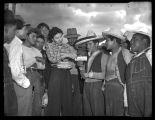 Mexican farm workers receiving paychecks, Skagit Valley, 1943