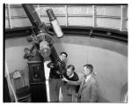 Men looking through a telescope at the University of Washington observatory, Seattle, 1934