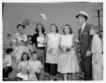 Contestants flipping pancakes at Pancake Festival, White Center, 1956