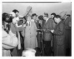 Teamsters president Dave Beck talking to reporters at Sea-Tac airport, March 20, 1957