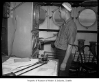 U.S. Coast Guard home defense patrol crew member inside the ship, 1942