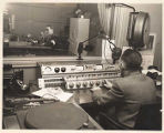 Two men in KIRO Radio broadcast booths,  ca. 1945