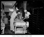 Men making bread at Langendorf Bakery, Seattle, 1938