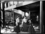 Three women in front of store window, Seattle, ca. 1906