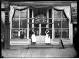 Two women in aprons in front of Index Bakery, Seattle, ca. 1906