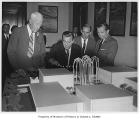 Senator Warren Magnuson showing model of Science Center to federal officials, Seattle World's...