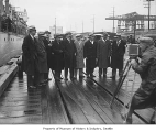 Aviator Carl B. Eielson with a group of men on docks, Seattle, 1929