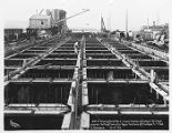 Constructing pontoons for the Lake Washington Floating Bridge, December 4, 1939