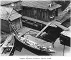 Canoes at boathouse, Seattle, ca. 1900