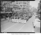 Navy volunteers marching on Fifth Avenue, Seattle, 1942