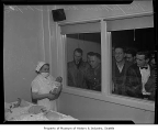 New fathers looking at babies inside Maynard Hospital, Seattle, 1944