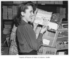 Nola Hines with ration book, Seattle, 1942