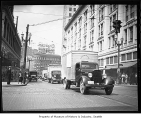 Goodwill trucks in downtown Seattle, 1936
