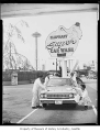 Elephant Car Wash sign showing men buffing a car and the Space Needle in the background, Seattle,...