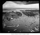 Aerial of boats in Portage Bay on opening day of boating season, looking southeast over the ship...