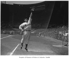 Seattle Rainiers outfielder Bill Matheson jumping to catch a ball, Seattle, 1944
