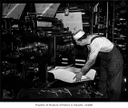 Man working at Seattle Star presses, Seattle, 1937