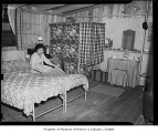 Internee Yoshi Hosokawa in her Camp Harmony barracks living area, Puyallup, 1942