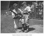 Seattle Rainiers manager Bill Skiff with batboy Junior Johnson, Seattle, August 1944
