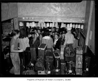 Greyhound Bus Terminal interior showing crowded baggage claim area, Seattle, 1948