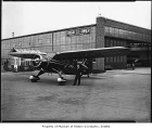 Airplane near hangar, 1935