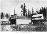 Gibbon store exterior showing people standing outside, Maple Valley, 1894