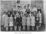 Maple Valley Grade School sixth grade class with J.A. Velie, Maple Valley, June, 1933