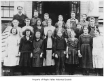 Hobart School seventh or eighth grade class outside school entrance with Mr. Neiswinder, Hobart,...