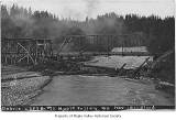 Columbia and Puget Sound Railroad Company bridge number 13 damaged after a flood, viewed at bridge...